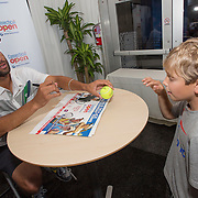 August 20, 2014, New Haven, CT:<br /> James Blake signs autographs during the legends party during the Men's Legends Event on day six of the 2014 Connecticut Open at the Yale University Tennis Center in New Haven, Connecticut Wednesday, August 20, 2014.<br /> (Photo by Billie Weiss/Connecticut Open)