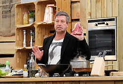 © Licensed to London News Pictures. 03/05/2014; Bristol, UK.  John Torode from BBC Master Chef does a live demonstration of cooking steak and Pad Thai at the Bristol Food Connections festival in the Harbourside area of the city.<br /> Photo credit: Simon Chapman/LNP