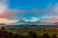 Mount Muhabura (13,540'), Mount Gahinga (11,398') and Mount Sabyinyo  (12,050'), all extinct volcanoes in the Virunga Mountains on the border of Uganda, Rwanda and Congo.