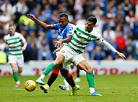 Football - 2019 / 2020 Ladbrokes Scottish Premiership - Rangers vs. Celtic<br /> <br /> Alfredo Morelos of Rangers vies with Hatem Abd Elhamed of Celtic, at Ibrox Stadium.<br /> <br /> COLORSPORT/BRUCE WHITE