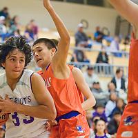 022213       Cable Hoover<br /> <br /> Miyamura Patriot Jared Meese (33) pushes past Los Lunas Tiger Chad Murphy (2) Friday at Miyamura High School.