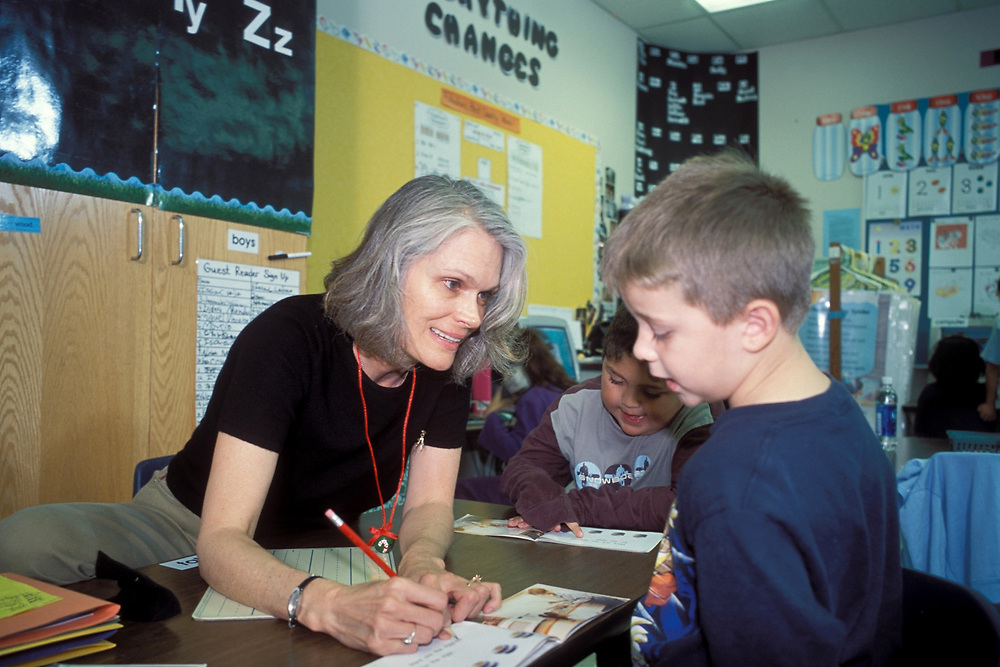 First Grade Teacher with Anglo student at Metz Elementary School in Austin, Texas.<br /> ©Bob Daemmrich/