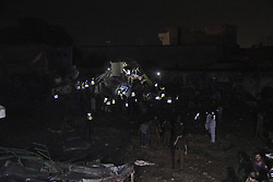 August 7, 2017 - Lahore, Pakistan - Pakistani security officials and rescue workers gather on site of bomb blast in Lahore,August 07,2017.An explosion injured at least 34 people late August 7 in Pakistan's eastern city of Lahore, officials said, with its cause not immediately clear.Photo  Irfan Ali  (Credit Image: © Irfan Ali/NurPhoto via ZUMA Press)