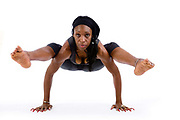 Jacqueline Scott in the firefly (tittibhasana) yoga position. Jaqueline, is a lawyer who practices ashtenga yoga daily