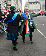 March 16, 2013 - New York, NY, U.S. - 'Leprechaun' NOEL RYAN dances with a fellow alumnus of Quinnipiac College  at the 252nd annual NYC St. Patrick's Day Parade. Thousands of marchers show their Irish pride, as they march up Fifth Avenue, and over a million people, often in green and orange, watch and celebrate.