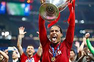 CHAMPIONS Liverpool defender Virgil van Dijk (4) lifts the trophy, tongue out, after the UEFA Champions League Final match between Tottenham Hotspur and Liverpool at Wanda Metropolitano Stadium, Madrid, Spain on 1 June 2019.