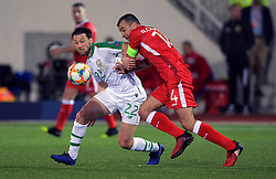 Republic of Ireland's Harry Arter and Gibraltar's Roy Chipolina (right) battle for the ball during the UEFA Euro 2020 Qualifying, Group D match at the Victoria Stadium, Gibraltar.