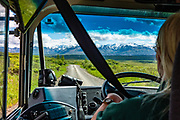 Run by concessionaire Doyon/ARAMARK Joint Venture, the non-narrated transit buses are green in Denali National Park and Preserve, Alaska, USA.