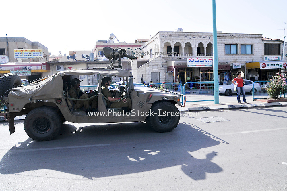 Israel, Golan Heights, The Druze vilege Massade Israeli Military vehicle drives through the village