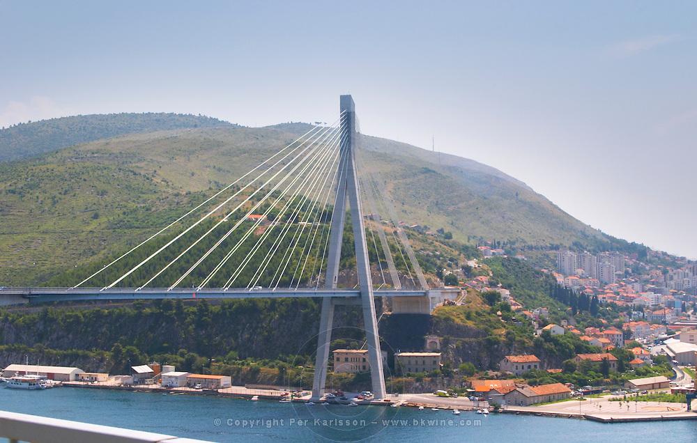 The new Dubrovnik Franjo Tudman Franja Tudmana suspension bridge at the entrance to Gruz docks harbour, Rijeka Dubrovacka bay and Kanal Daksa canal. Dubrovnik, new city. Dalmatian Coast, Croatia, Europe. Designed by Mladen Ulicevic.