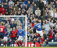PORTSMOUTH 2 V SCUNTHORPE UNITED 1.     24.1.04. <br /> PORTSMOUTH'S CAPTAIN TEDDY SHERINGHAM WAS UNLUCKY WITH THIS HEADER AGAINST SCUNTHORPE IN THE F.A. CUP FOURTH ROUND MATCH AT FRATTON PARK.<br /> PIC BY HARRY HERD/SPORTSBEAT IMAGES
