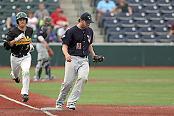 06 July 2013:  Jake Stephens covers first tagging it for an out ahead of runner Oscar Garcia during a Frontier League Baseball game between the Gateway Grizzlies and the Normal CornBelters at Corn Crib Stadium on the campus of Heartland Community College in Normal Illinois