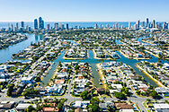Aerial view of canal homes behind Surfers Paradise skyline, Gold Coast, Queensland, Australia