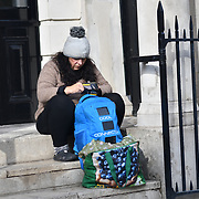 A homeless lady sitting at the corner of St Martin-in-the-Fields Westend, London, UK. 23 September 2018.
