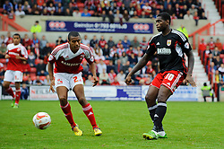 Bristol City Midfielder Jay Emmanuel-Thomas (ENG) is challenged by Swindon Defender Nathan Thompson (ENG) during the second half of the match - Photo mandatory by-line: Rogan Thomson/JMP - Tel: 07966 386802 - 21/09/2013 - SPORT - FOOTBALL - County Ground, Swindon - Swindon Town v Bristol City - Sky Bet League 1.