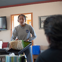 LaFrenda Yazzie, 20, a farm intern from Beshbetoh, AZ teaches the compost class how to create fodder for the animals to eat at the Spirit Farm in Vanderwagon Friday.