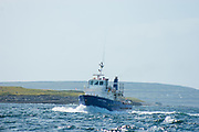 Happy Hooker, Inishmore, Aran Islands. Doolin ferries Happy hooker ferry en route from Inishmore to Doolin.