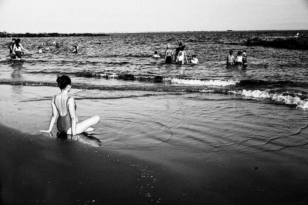 CONEY ISLAND - PEOPLE SWIMMING IN OCEAN
