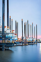 Liftboats are stored at the Port of Iberia in New Iberia, La, Falling oil prices is slowing energy production and causing the oil and gas industry to layoff thousands of workers throughout Louisiana.