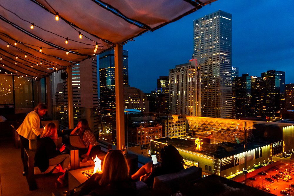 The 54Thirty (the highest rootop bar in Denver at 5430 feet above sea level), on the 20th floor of the Le Meridien Hotel, Downtown Denver, Colorado USA. On the right side is the tallest building in Denver, the Republic Plaza Building.