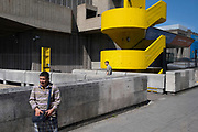 Two men are seen on the Southbank's brutalist concrete architecture, on 16th July 2021, in London, England.