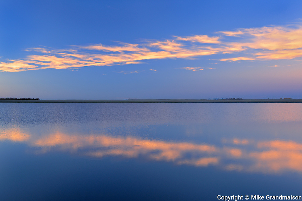 Clouds reflected in wetland at sunset<br /> Tuxford<br /> Saskatchewan<br /> Canada