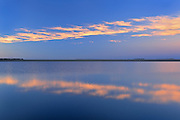 Clouds reflected in wetland at sunset<br /> Tuxford<br /> Saskatchewan<br /> Canada