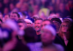 Football pundit Robbie Savage watches the darts during day thirteen of the William Hill World Darts Championships at Alexandra Palace, London.