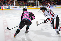 KELOWNA, CANADA - OCTOBER 21: Dillon Dube #19 of the Kelowna Rockets moves the puck over centre ice as Kieffer Bellows #22 of the Portland Winterhawks back checks from the boards on October 21, 2017 at Prospera Place in Kelowna, British Columbia, Canada.  (Photo by Marissa Baecker/Shoot the Breeze)  *** Local Caption ***