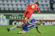 Max Power (Wigan) fouls Jake Hessenthaler (Gillingham) during the Sky Bet League 1 match between Wigan Athletic and Gillingham at the DW Stadium, Wigan, England on 7 January 2016. Photo by Mark P Doherty.