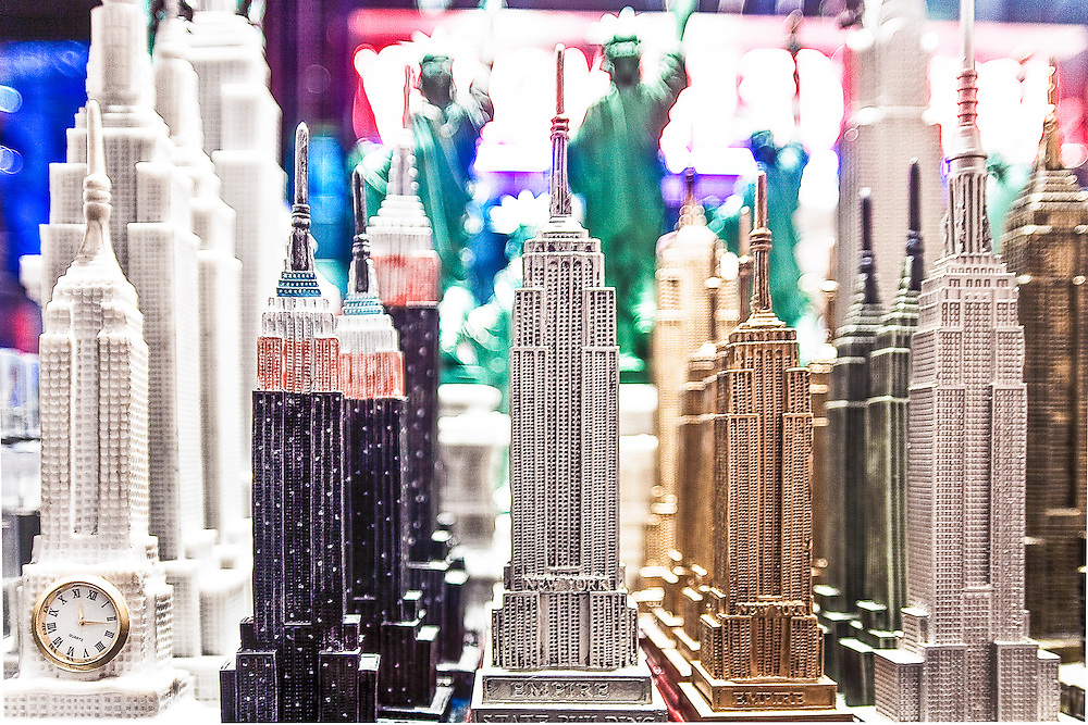 Empire State Building and Statue of Liberty statuettes in a souvenir shop near New York's Times Square.