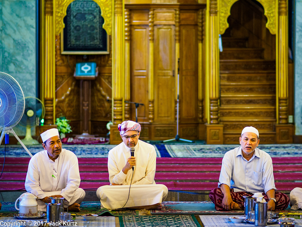 14 JUNE 2017 - BANGKOK, THAILAND: Men pray before Iftar at Masjid Hidayatun Islam. Iftar is the evening meal when Muslims end their daily Ramadan fast at sunset. Iftar is a communal event at Masjid Hidayatun Islam and more than a hundred people usually attend the meal.      PHOTO BY JACK KURTZ