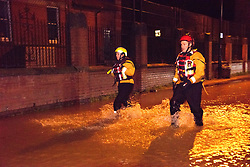 © Licensed to London News Pictures. 24/02/2020. Shrewsbury, Shropshire, UK. The Shropshire Fire and Rescue Service carry out an evacuation operation in the Coleham area of Shrewsbury in Shropshire as the River Severn levels continue to rise UK causing severe flood disaster situations. The Environment Agency forecast levels to peak tomorrow evening at around 5.56 metres. Photo credit: Graham M. Lawrence/LNP