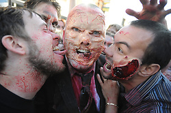 "© Licensed to London News Pictures. 15/09/2013<br /> Brentwood zombie movie ""Welcome to Essex""<br /> The final shoot of  Welcome to Essex  has seen 1500 zombies running down Brentwood High Street this morning (15.09.2013) on the last day of filming for one of the biggest low-budget horror films.<br /> The film follows  Ryley Dunn played by Catherine Delaloye who after a drunken fall that lands her unconscious wakes up to find Brentwood over run with Zombies...<br /> Photo credit :Grant Falvey/LNP"