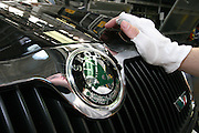 Mlada Boleslav/Tschechische Republik, Tschechien, CZE, 16.03.07: Mitarbeiter am Fertigungsband beim Polieren des Logos einer Skoda Octavia Karosserie in der Skoda Autofabrik in Mlada Boleslav. Der tschechische Autohersteller Skoda ist ein Tochterunternehmen der Volkswagen Gruppe.<br /> <br /> Mlada Boleslav/Czech Republic, CZE, 16.03.07: Detail of Skoda Octavia car model front mask with Skoda emblem beiing polished at Skoda car factory in Mlada Boleslav. Czech car producer Skoda Auto is subsidiary of the German Volkswagen Group (VAG).