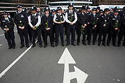 Thousands of people including police officers and Muslim faith leaders gathered on Westminster Bridge to hold a vigil and a minutes silence one week after the terror attack, on March 29th 2017 in London, United Kingdom. Metropolitan Police stand in lines holding white roses in memory of their colleague and members of the public.