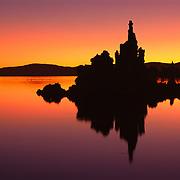 Unique tufa formations (calcium carbonate) silhouetted in pre-dawn light in Mono Lake. Mono Lake, CA.