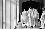 Monks make their way to the prayer chapel at Sancta Maria Abbey at Nunraw, East Lothian, home since 1946 to the Order of Cistercians of the Strict Observance. Around 15 monks were resident at Nunraw in 1996, undertaking a mixture of daily tasks and strict religious observance. The present purpose-built building dates from 1969 when the monks moved from the nearby Nunraw house.