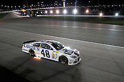 Jimmy Johnson (48) races in a NASCAR Sprint Cup series night race, Saturday, May 10, 2014, at Kansas Speedway in Kansas City, Kan. (AP Photo/Colin E. Braley)