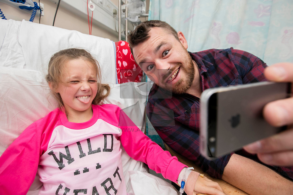 Repro Free:<br /> Ireland and Leinster rugby star Cian Healy is pictured with Hannah Donohue (9) in Temple Street Children's Hospital at the launch of the King Koil Sleeptember Campaign. Encouraging the nation to join the  #BedHeadSelfie initiative in aid of Temple Street Children's Hospital. Picture Andres Poveda
