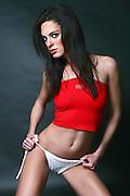 Female model in bikini and red top, studio