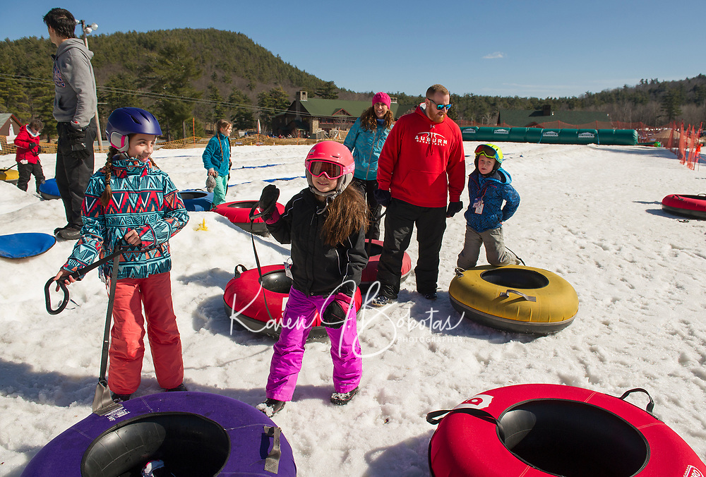 The Moynihan and Lockwood families visiting from Auburn NH take in an afternoon of tubing at Gunstock Thursday afternoon.  (Karen Bobotas/for the Laconia Daily Sun)