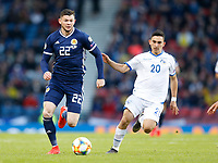 Football - 2018 / 2019 UEFA European Championship Qualifier - Group I: Scotland vs. Cyprus<br /> <br /> Oliver Burke of Scotland vies with Ioannis Kosti of Cyprus  during the European Championship Qualifying match between Scotland and Cyprus, at Hampden Park, Glasgow.<br /> <br /> COLORSPORT/BRUCE WHITE