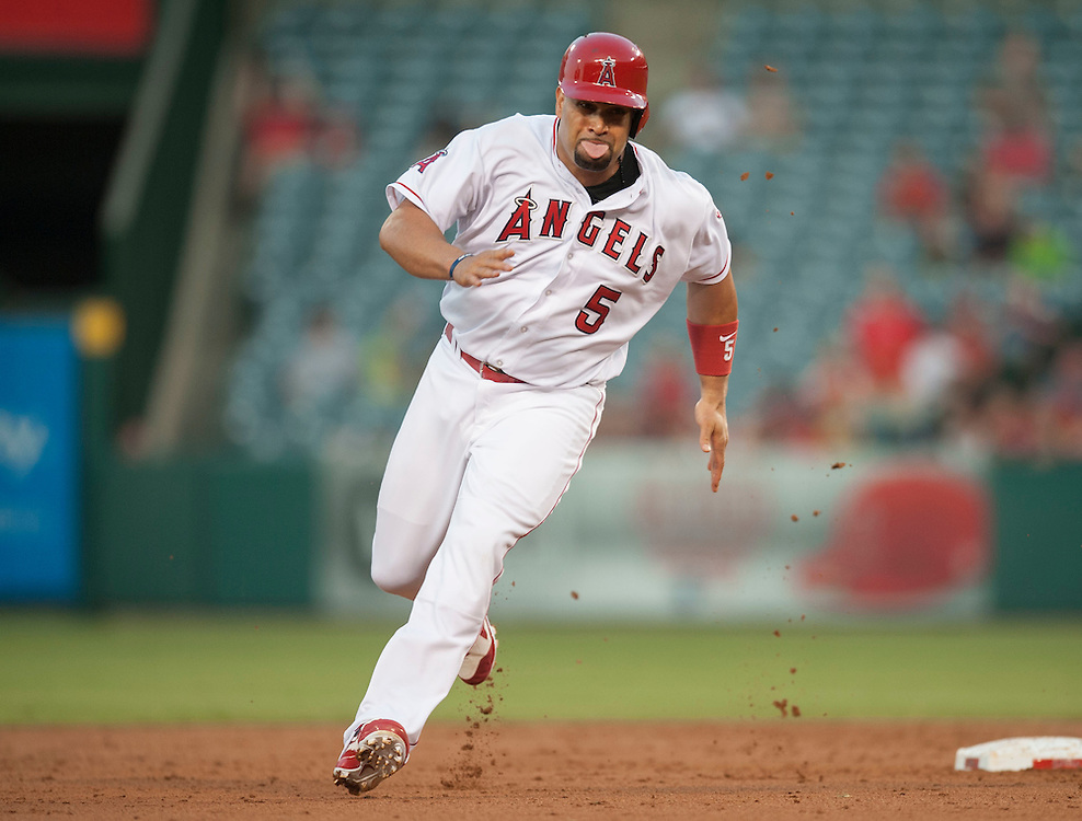 The Angels' Albert Pujols heads for third against the Boston Red Sox at Angel Stadium on Friday.<br /> <br /> ///ADDITIONAL INFO:   <br /> <br /> angels.0730.kjs  ---  Photo by KEVIN SULLIVAN / Orange County Register  -- 7/29/16<br /> <br /> The Los Angeles Angels take on the Boston Red Sox at Angel Stadium.