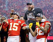Kansas City Chiefs' Patrick Mahomes, left, Travis Kelce, center, and Tyrann Mathieu, right, celebrate after winning a NFL, AFC Championship football game against the Tennessee Titans, Sunday, Jan. 19, 2020, in Kansas City, MO. The Chiefs won 35-24 to advance to Super Bowl 54. (AP Photo/Colin E. Braley)
