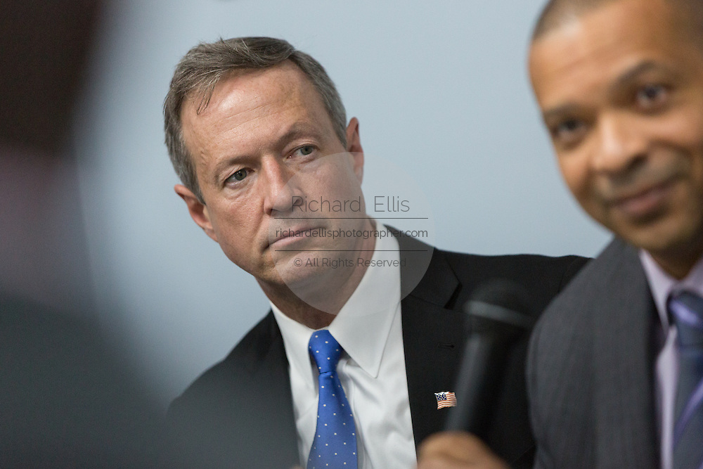 Former Maryland Governor and Democratic presidential candidate Martin O'Malley (left) listens to South Carolina State Senator Marlon Kimpson during a discussion on gun violence at Mt. Moriah Baptist Church October 22, 2015 in North Charleston, South Carolina.