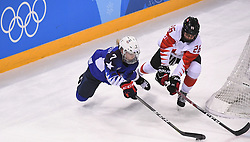 PYEONGCHANG, Feb. 22, 2018  Monique Lamoureux-Morando of the United States (L) vies for the puck during women's ice hockey final against Canada at Gangneung Hockey Centre, in Gangneung, South Korea, Feb. 22, 2018. The United States beat Canada in shootout to win the women's ice hockey gold medal at the Winter Olympic Games here on Thursday. (Credit Image: © Wang Haofei/Xinhua via ZUMA Wire)