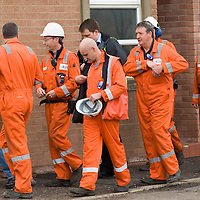 EDINBURGH, UNITED KINGDOM - APRIL 25: Workers at the Grangemouth Oil Refinery walk out from a union meeting April 25, 2008 in Edinburgh, Scotland. Workers at the plant are to take part in a two day strike from Sunday in a dispute over pensions.