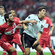 Turkey's Egemen KORKMAZ (L) and Germany's Mario GOMEZ (R) during their UEFA EURO 2012 Qualifying round Group A matchday 19 soccer match Turkey betwen Germany at TT Arena in Istanbul October 7, 2011. Photo by TURKPIX
