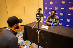 Michigan Wolverines defensive lineman Kwity Paye speaks with the media at the Hyatt Regency on Monday, December 24, 2018 in Atlanta. Michigan will face Florida in the 2018 Peach Bowl on December 29, 2018. (Jason Parkhurst via Abell Images for the Chick-fil-A Peach Bowl)
